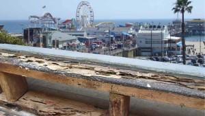 termite damaged railing in los angeles coastal town