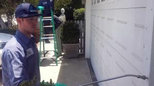 tech applies termite treatment san diego home